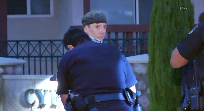 Suspect in killing of three homeless men and injury to two others, later identified as Jon David Guerrero, is detained  in downtown San Diego June 15, 2016.