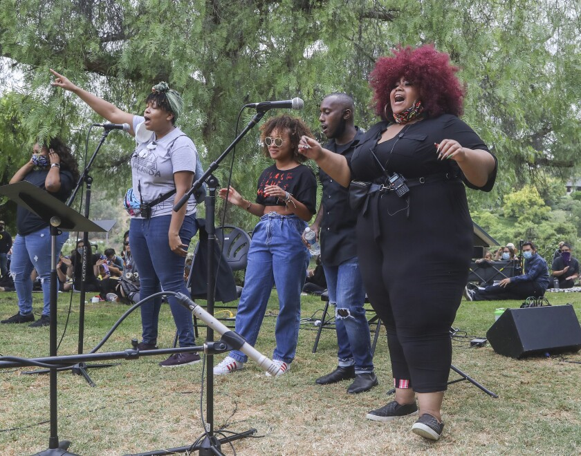 Artists 4 Black Lives Matter sit in/sing in.