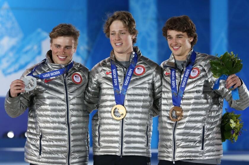 Gus Kenworthy, left, Joss Christensen and Nicholas Goepper medal in the ski slopestyle event.