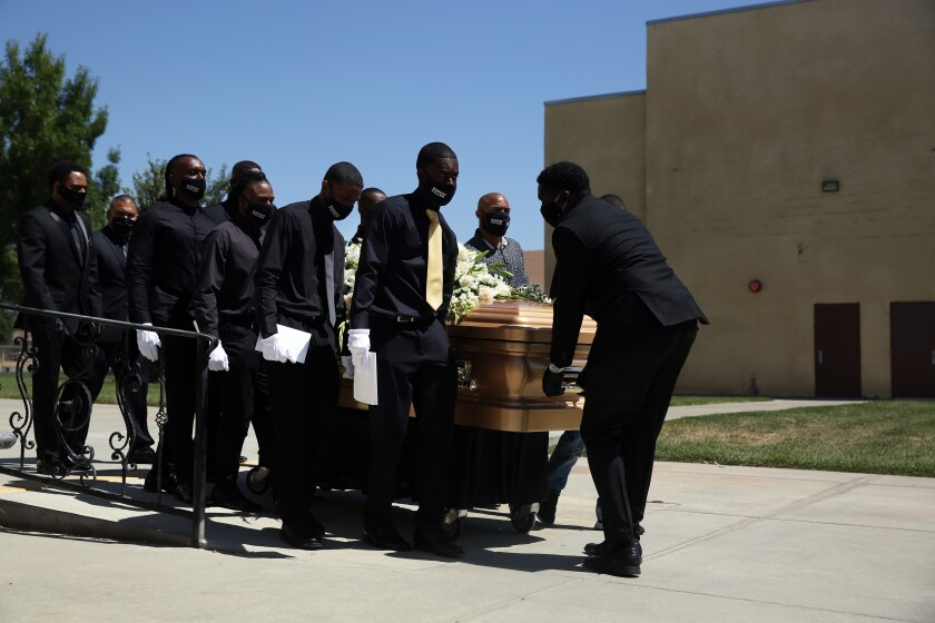 Pallbearers carry Robert Fuller's casket June 30 at Living Stone Cathedral of Worship in Littlerock, Calif.