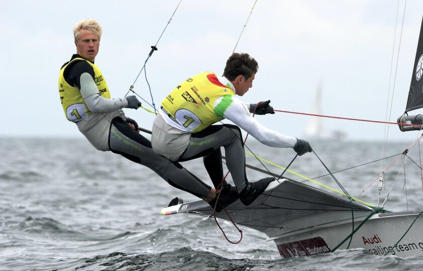 FILE-German sailors Erik Heil, left, and und Thomas Plößel compete in a 49 class race on the Baltic Sea near Kiel-Schilksee June 25, 2013. Erik Heil has fallen ill and is getting daily hospital treatment for several infections after competing in polluted water at a test event for next year's Olympics in Rio de Janeiro.(Carsten Rehder/dpa via AP)