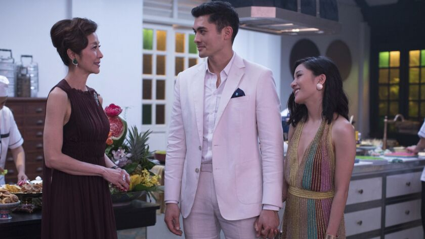 This image released by Warner Bros. Entertainment shows Michelle Yeoh, from left, Henry Golding and