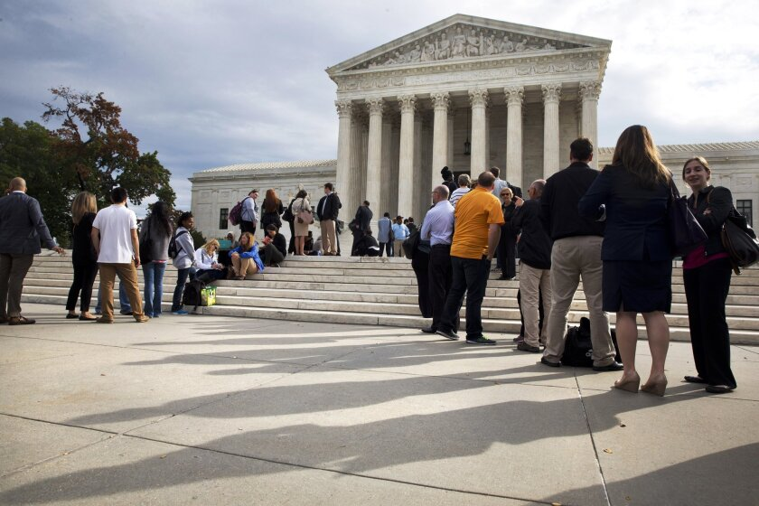 Visitors line up outside of the Supreme Court on Oct. 13, 2015, as the justices begin discussing prisoners who were sentenced as juveniles to life without parole. The court has repeatedly limited such sentences and is set to consider further limits in the Mississippi case of a 15-year-old killer.
