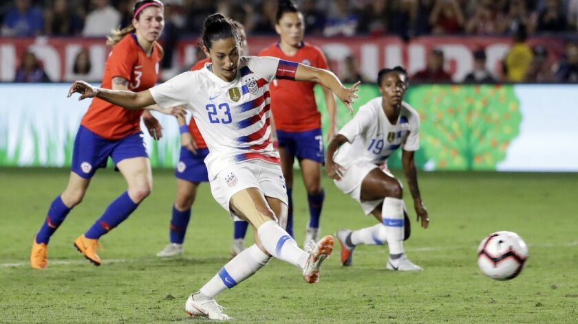United States' Christen Press scores on a penalty kick against Chile during the first half of an international friendly soccer match on Aug. 31, 2018, in Carson.