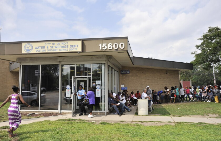 Customers wait in line at the Detroit Water and Sewerage Department's Westside Customer Service Center. Monday marked the end of the water shut-off moratorium.