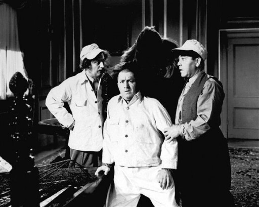 This undated image of The Three Stooges, originally released by Columbia Pictures, shows from left, Larry Fine, Curly Howard and Moe Howard. (AP Photo/Columbia Pictures)