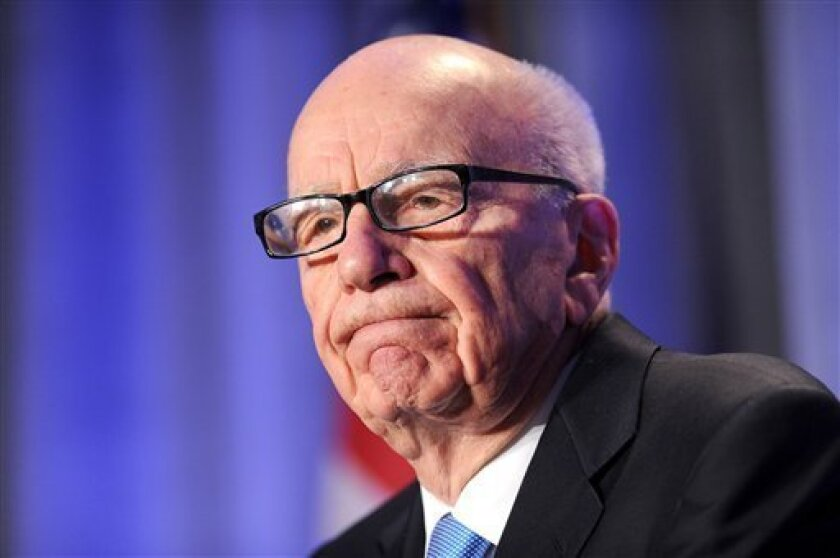 """FILE - In this Oct. 14, 2011 file photo, News Corp. CEO Rupert Murdoch delivers a keynote address at the National Summit on Education Reform in San Francisco. News Corp. chairman Rupert Murdoch has been recorded calling wrongdoing by his British newspapers """"next to nothing"""" and apparently acknowledging that his reporters paid police officers for information. In a tape published in transcript by the ExaroNews journalism website and broadcast Wednesday July 3, 2013 on Channel 4 News, Murdoch is h"""