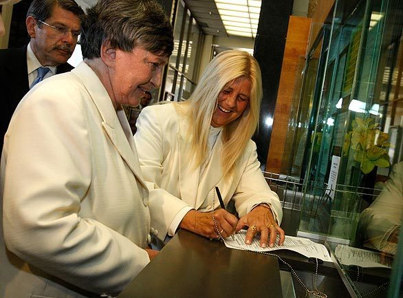 Robin Tyler, left, and Diane Olson sign their marriage certificate. They were the first and only couple in Los Angeles County to obtain a marriage license Monday, after same-sex marriage became legal in California at 5:01 p.m. by order of the state Supreme Court. More coverage • With gay marriage now legal in California, it's the start of a couples' crush • Opponents of gay marriage stay mostly quiet -- for now