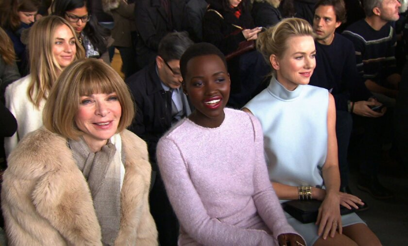 This image from video shows Vogue editor Anna Wintour, from left, and actresses Lupita Nyong'o and Naomi Watts attending the Fall 2014 Calvin Klein collection during Fashion Week in New York, Thursday, Feb. 13, 2014. (AP Photo/APTV)