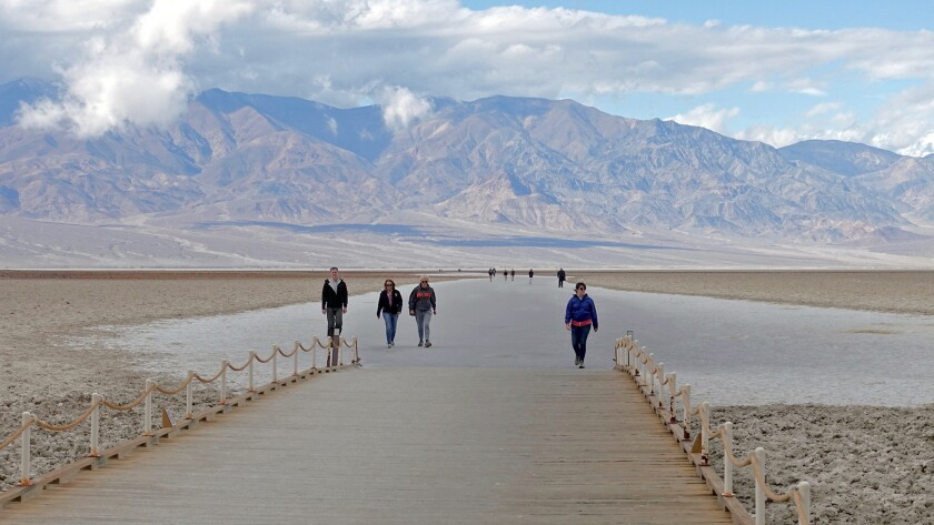 Death Valley, CA ? November 29: Visitors walk on the salt-crusted mud flat of Badwater Basin. At 282