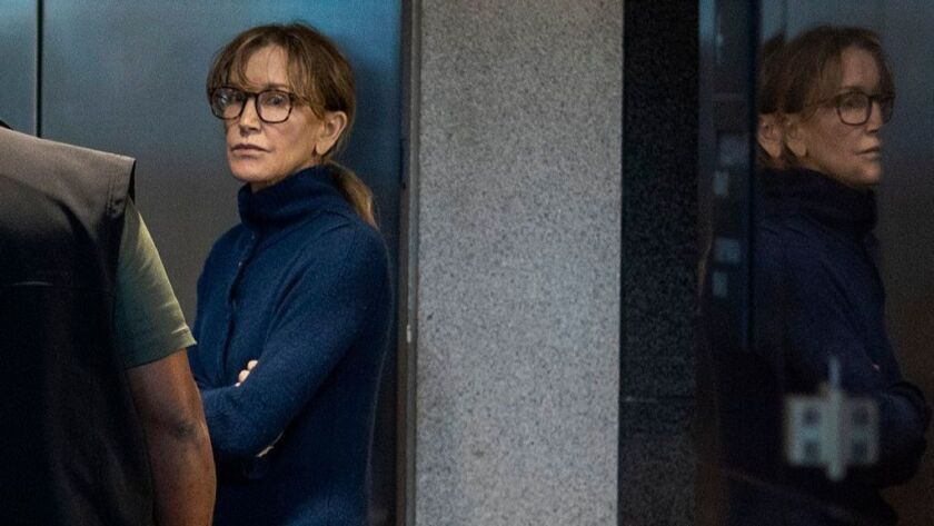 Actress Felicity Huffman, who was arrested in connection with a college admissions scandal, is seen inside the Edward R. Roybal Federal Building and U.S. Courthouse in Los Angeles on March 12.