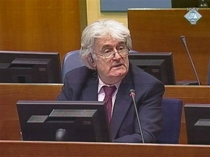 "In this image taken from International Criminal Tribunal for the former Yugoslavia (ICTY) TV camera, showing Former Bosnian Serb leader Radovan Karadzic as he gives his opening statement on Monday, March 1, 2010, at the U.N. war crimes tribunal for the former Yugoslavia. Karadzic faces charges of genocide and war crimes, accused of orchestrating a campaign to destroy the Muslim and Croat communities in eastern Bosnia to create an ethnically pure Serbian state. Karadzic told the tribunal his cause ""is just and holy"" and that he has a good case against the accusations. (AP Photo/ICTY)"