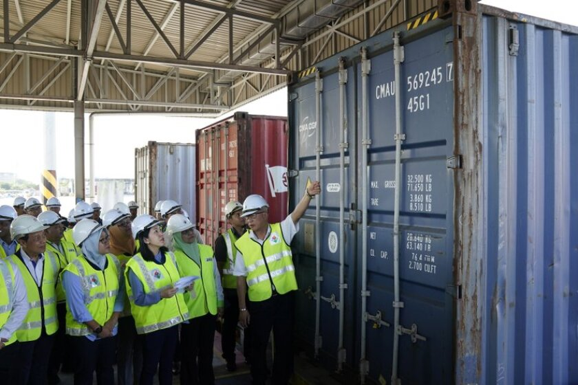 Malaysia's Environment Minister Yeo Bee Yin, third from left, inspects a container with plastic waste at a port in Butterworth, Malaysia, on Jan. 20, 2020. Malaysia has sent back 150 containers of plastic waste to 13 mainly rich countries.