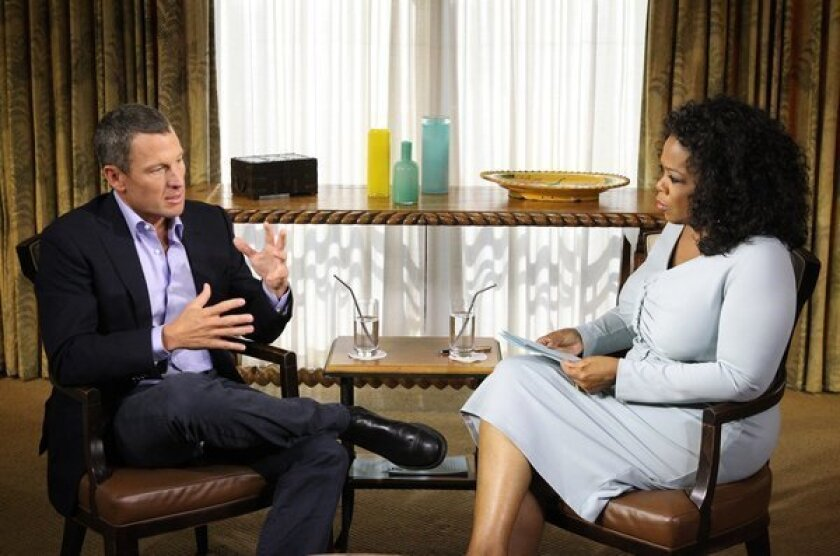 Banned cyclist Lance Armstrong, left, talks to Oprah Winfrey about performance enhancing drugs in an interview that is to air later this week.