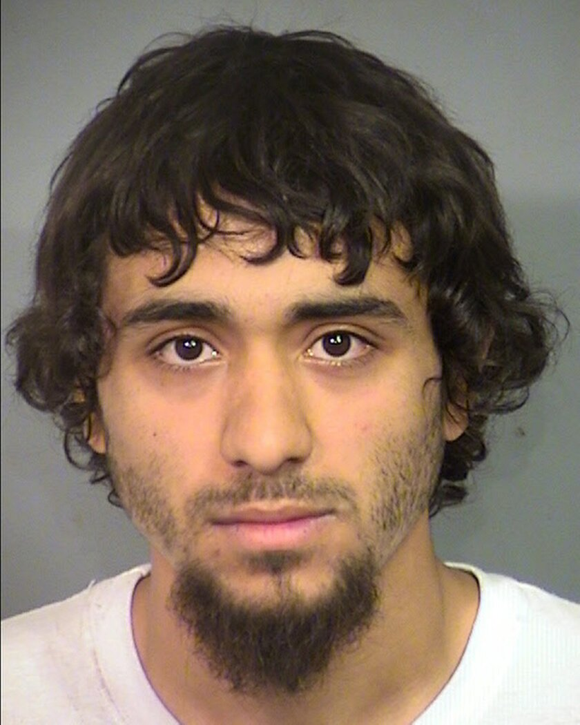 This undated booking photo provided by the Las Vegas Metropolitan Police Department shows Bryce Matthew Cuellar of Las Vegas. He is being held following his indictment on conspiracy and terrorism threat charges after police and prosecutors say he posed in battlefield gear with assault weapons and d