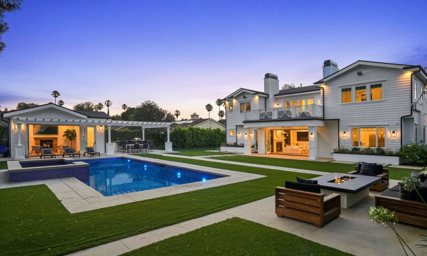 Built in 2018, the 5,800 square foot Cape Cod features a movie theater, game room, gazebo, living room and swimming pool.
