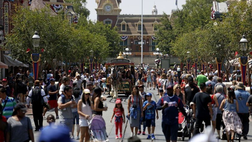Guests along Main Street in Disneyland in 2017. The theme park is appealing a Cal-OSHA citation and fine for failing to properly clean cooling equipment linked to last year's Legionnaires' disease outbreak.