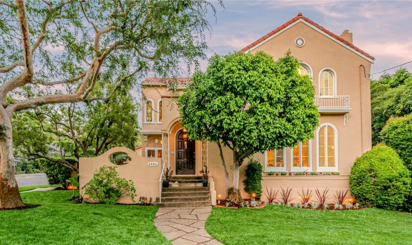 Built in 1925, the Spanish-style home stays in touch with its roots with dramatic arched windows and tray ceilings.