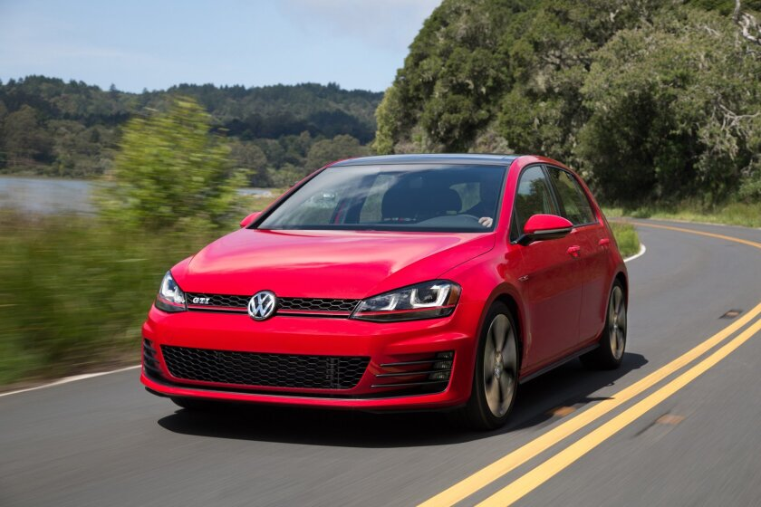 This undated photo made available by Volkswagen shows the 2015 Volkswagen Golf GTI. The new GTI shed up to 82 pounds from its predecessor's weight and now is just over 3,000 pounds. (Volkswagen via AP)