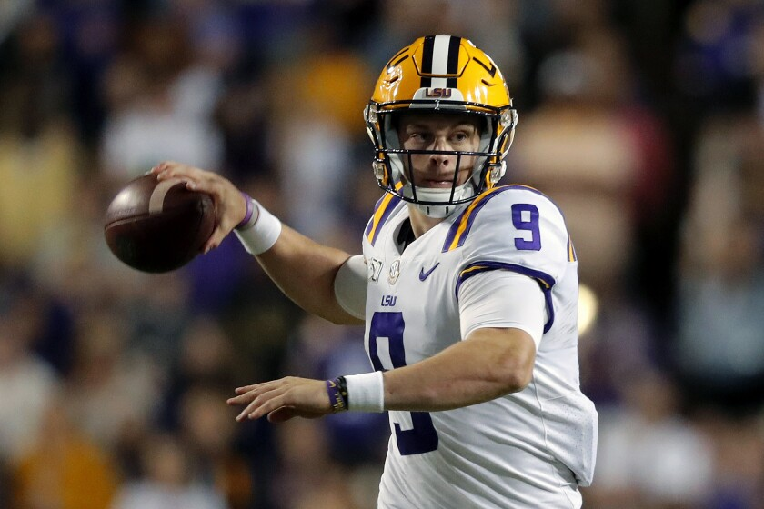 FILE - In this Oct. 12, 2019, file photo, LSU quarterback Joe Burrow (9) passes in the second half of an NCAA college football game against Florida, in Baton Rouge, La. Burrow was selected to the AP Midseason All-America NCAA college football team, Tuesday, Oct. 15, 2019. (AP Photo/Gerald Herbert)
