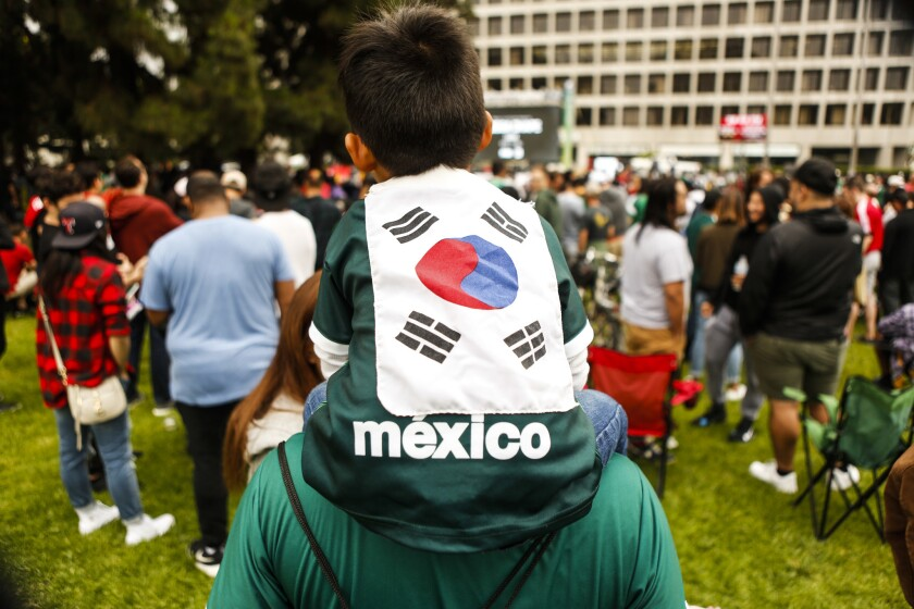 Ayden Martinez-Shin, 4, wears a Mexico shirt decorated with a South Korean flag to show support for both teams at the World Cup watch party Saturday morning at Wilshire Park Place in Koreatown.