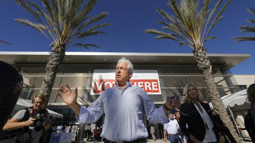John Cox, Republican candidate for California governor leaves the San Diego County Registrar of Voters office after dropping off his mail-in ballot on Friday.