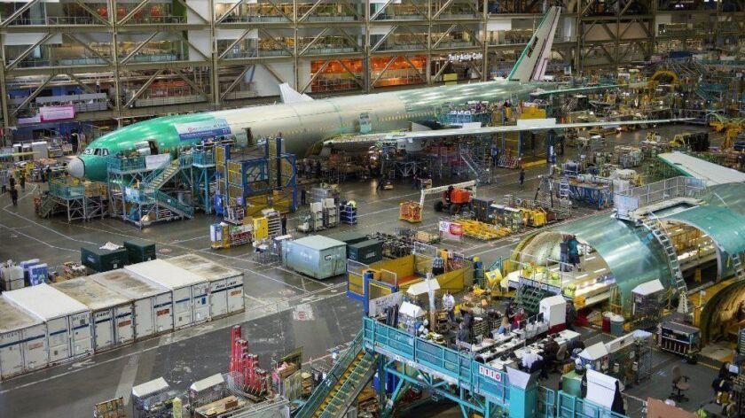 "Boeing 777s are built in 2013 in Everett, Wash. An insider said Boeing routinely uses accounting tricks to beat expectations. ""It all gets blessed by accounting. Nobody is breaking the law,"" the insider said. ""But financial engineering is artificially boosting the stock price."""