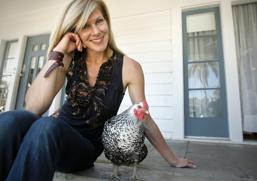 Holly Berkley with one of her chickens, a Silver Laced Wyandotte.