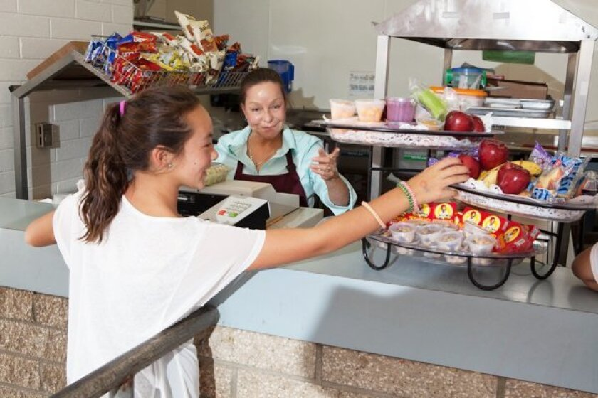 A student makes a healthy choice of fruit at the cafeteria. Courtesy photos