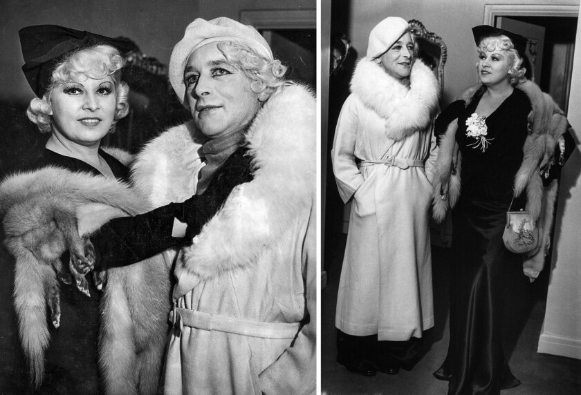Oct. 7, 1935: Actress Mae West, in black dress, and Harry Dean, a district attorney's office investigator who impersonated West, pose for photographers after a suspect was detained in an extortion case.