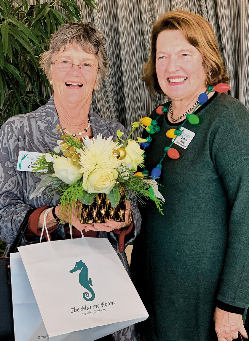 VGCLJ members Lacey Colmore and Bonnie Sipe attend the Village Garden Club of La Jolla's Holiday Luncheon, Dec. 12, 2019 at The Marine Room in La Jolla.