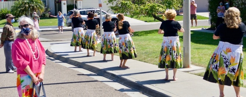 TextEditor Hula dancers perform on the sidewalk in front of hula teacher Christinia Lee's house to celebrate her 102nd birthday.