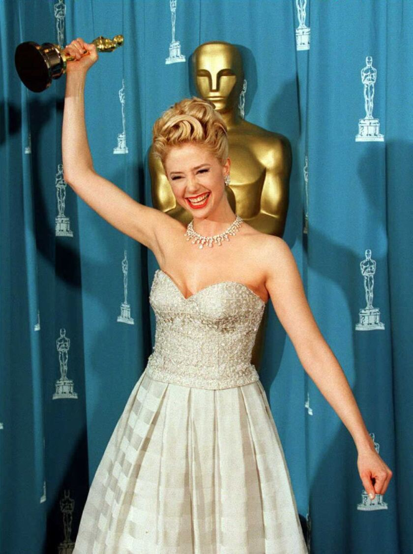 Actress Mira Sorvino brandishes her Oscar after wi
