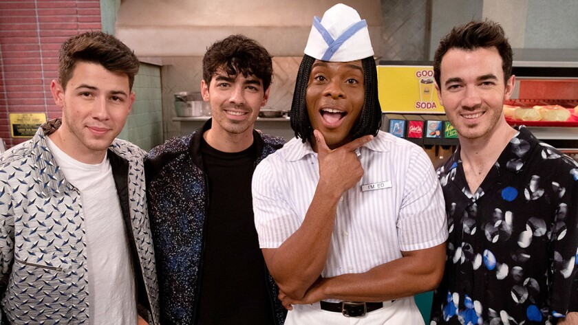 "The Jonas Brothers (Nick, left, Joe and Kevin, right) perform Nickelodeon's rebooted variety-for-kids series ""All That."" with Kel Mitchel."