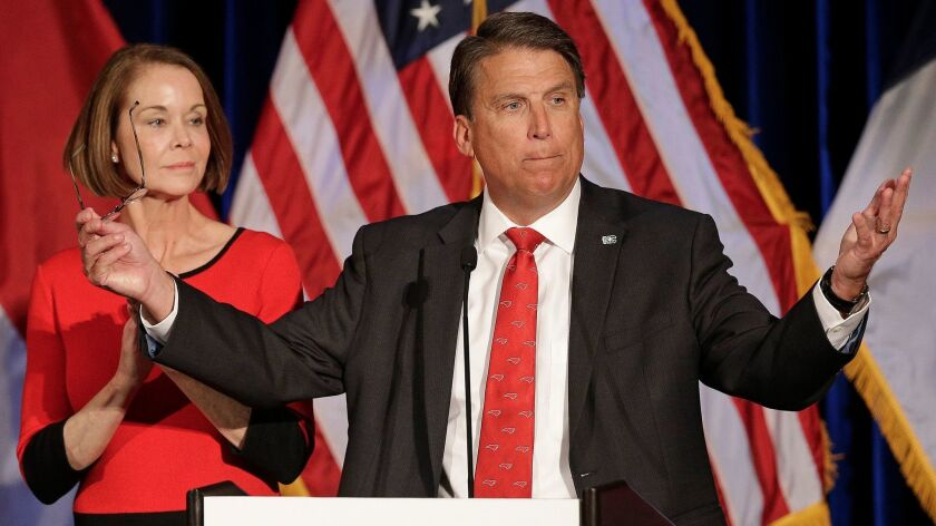 North Carolina Gov. Pat McCrory speaks to supporters as his wife Ann McCrory listens at an election rally in Raleigh, N.C., on Wednesday, Nov. 9, 2016.