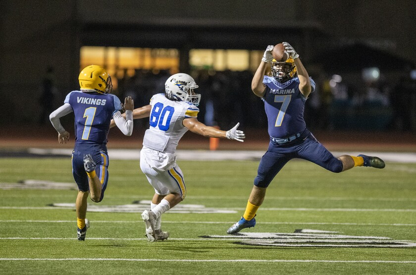 Marina's Cade Jackman intercepts a pass intended for Fountain Valley's Drew Reyes  at Westminster High School on Friday.