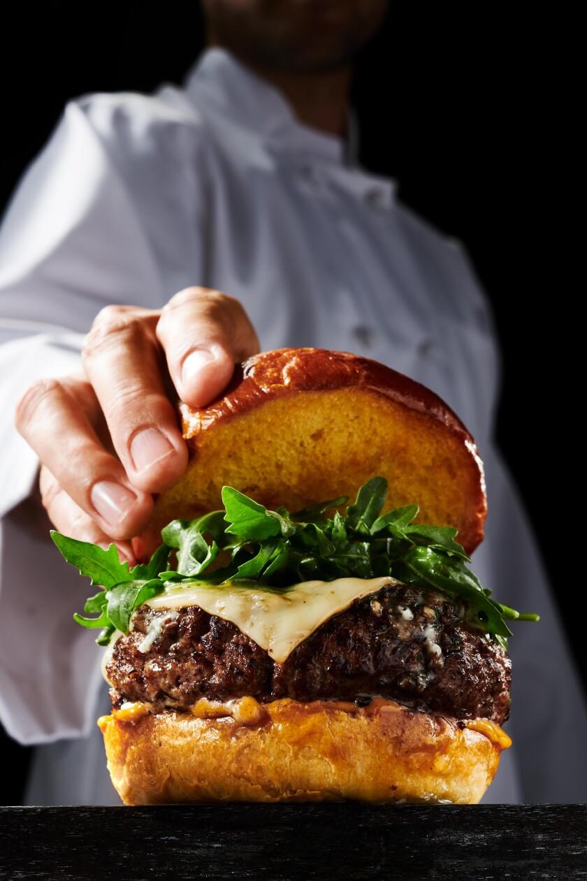 Del Frisco's steakhouse burger hand.
