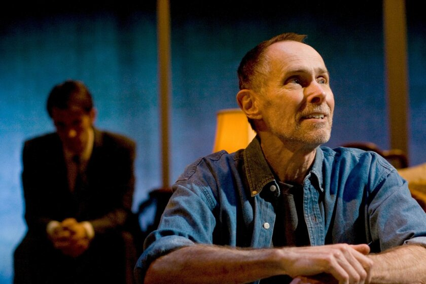 """Dakin (Jim Winker, foreground) eyes the horizon while son Spencer (Francis Gercke) sits in the shadows, in Stephen Metcalfe's new play """"The Tragedy of the Commons"""" at Cygnet Theatre."""