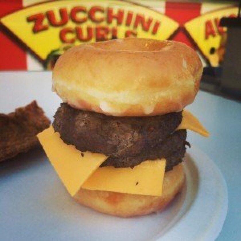 Fair mainstay Chicken Charlie's sold more than 20,000 Krispy Kreme triple-decker cheeseburgers made with 60,000 hamburgers and 40,000 donuts. Photo/Karen Billing
