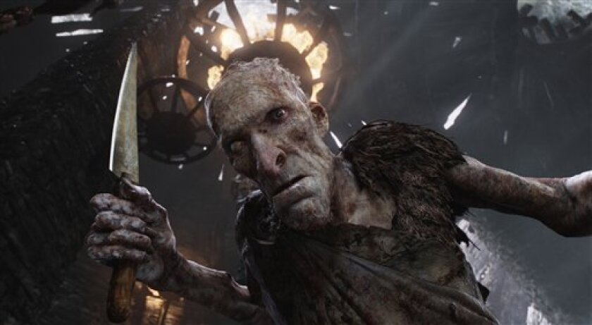 """This film image released by Warner Bros. Pictures shows the character Cook, voiced by Philip Philmar, in a scene from """"Jack the Giant Slayer."""" (AP Photo/Warner Bros. Pictures)"""