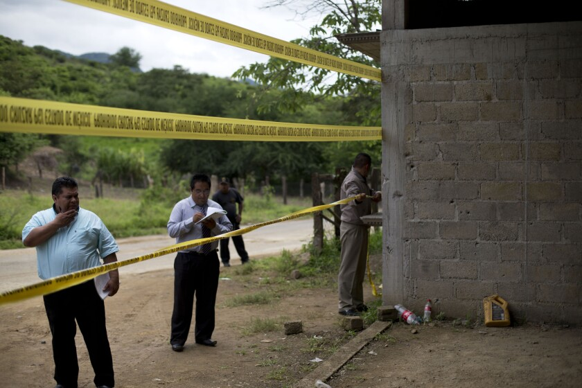 State authorities seal off a warehouse in Tlatlaya, Mexico, that was the site of a shootout between Mexican soldiers and gang members.