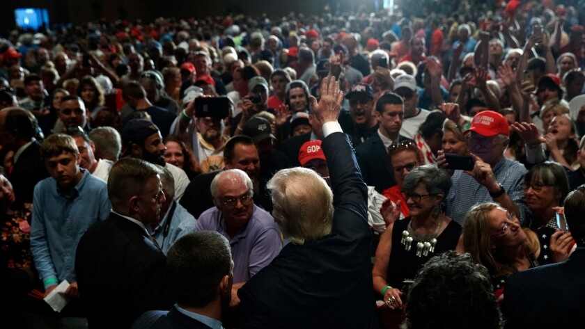 Republican presidential candidate Donald Trump waves as he leaves a campaign rally on Aug. 12 in Altoona, Pa.