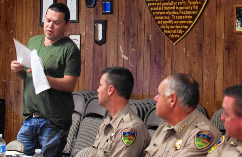 Ryan Jackson, Hoopa Valley tribal chairman, speaks at a meeting with Humboldt County sheriff's officials, including Sheriff Mike Downey, second from right. The tribal council has approved a $1.7-million law enforcement budget for 2016 — a nearly $500,000 increase over last year. The tribe is also pursuing other avenues to gain greater law enforcement authority on their lands.