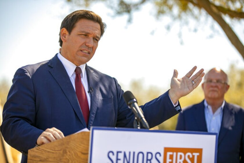 FILE - In this March 5, 2021 file photo, Florida Gov. Ron DeSantis speaks to the media as he visited the drive-thru COVID-19 vaccination site at On Top of the World in Ocala, Fla., Repealing statewide mask mandates and criticizing the Biden administration's unemployment-based formula for distributing billions in federal aid has put Republican governors and their approach to handling the coronavirus pandemic back in the spotlight. (Alan Youngblood/Ocala Star-Banner via AP)