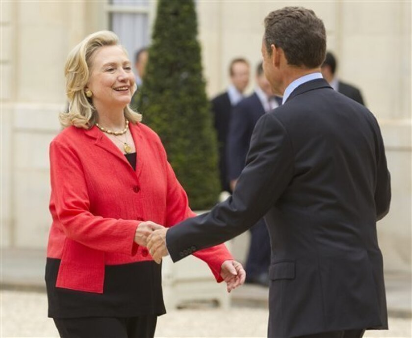 Secretary of State Hillary Rodham Clinton meets with French President Nicolas Sarkozy at the Elysee Palace in Paris, Thursday, Sept. 1, 2011. (AP Photo/Evan Vucci, Pool)