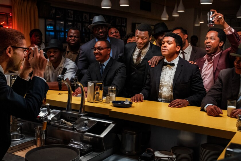 """Aldis Hodge (third from right), Eli Goree (second from right) and Leslie Odom Jr. in a scene from """"One Night in Miami."""""""