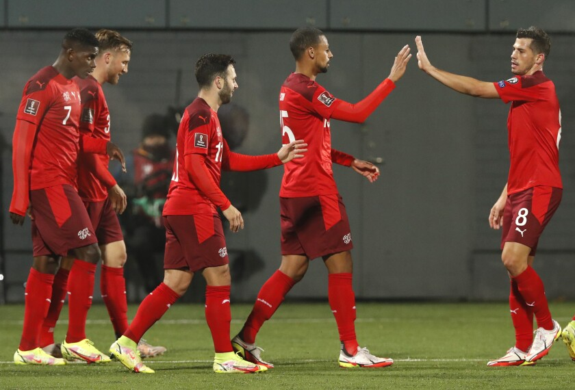 Switzerland's players celebrate after Switzerland's Renato Steffen scored his side's second goal during the World Cup 2022 Group C qualifying soccer match between Lithuania and Switzerland at LFF stadium in Vilnius, Lithuania, Tuesday, Oct. 12, 2021. (AP Photo/Mindaugas Kulbis)
