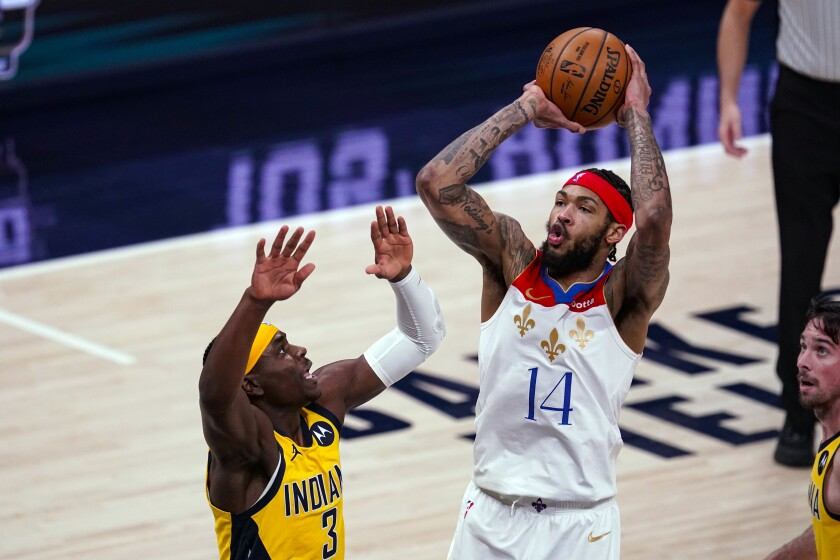 New Orleans Pelicans forward Brandon Ingram (14) shoots over Indiana Pacers guard Aaron Holiday (3) during the second half of an NBA basketball game in Indianapolis, Friday, Feb. 5, 2021. (AP Photo/Michael Conroy)