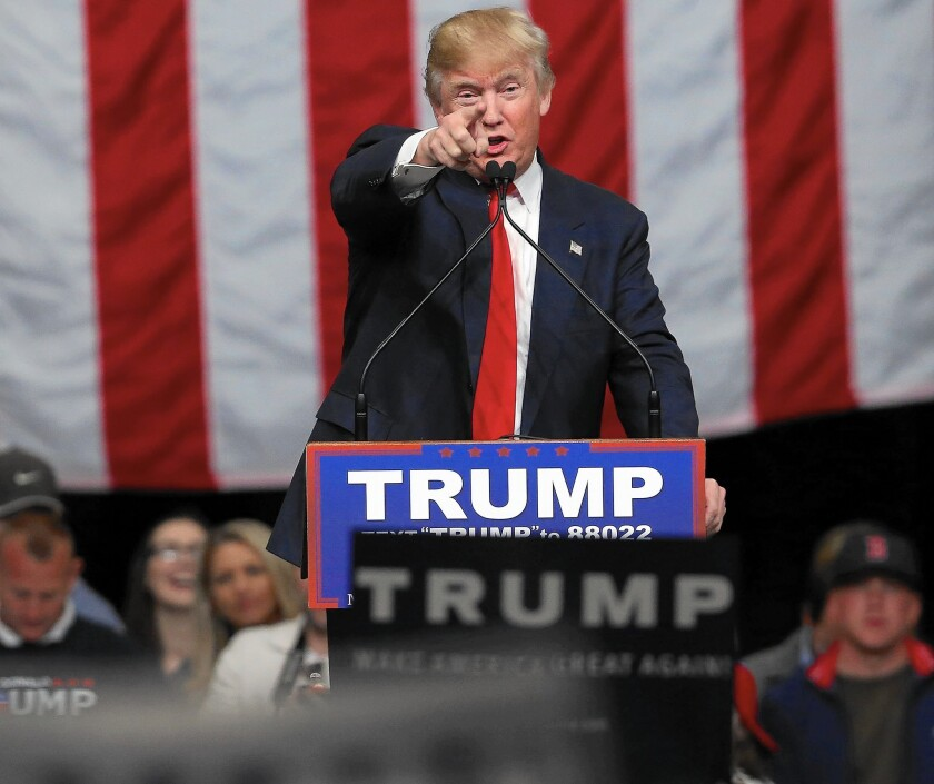 Donald Trump speaks to South Carolina voters Friday on the eve of the state's primary. The billionaire leads in polls in the state.