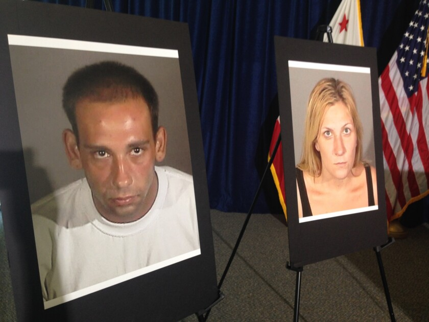 Gus Adams, 26, and Andrea Miller, 28, are suspected of breaking into a man's home in Long Beach, police say. Miller, who may have been pregnant, was fatally shot by the homeowner.